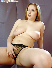 Hot fatty with enormous melons rubs her twat hole